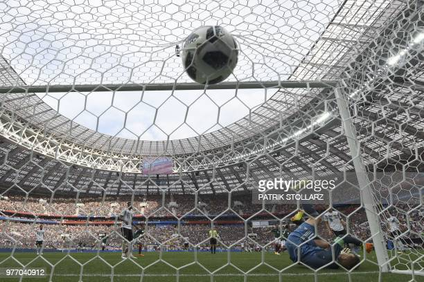 TOPSHOT Germany's goalkeeper Manuel Neuer fails to stop a ball as Mexico's forward Hirving Lozano celebrates after scoring a goal during the Russia...