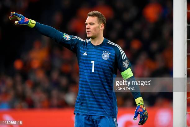 Germany's goalkeeper Manuel Neuer gestures during the UEFA Euro 2020 Group C qualification football match between The Netherlands and Germany at the...