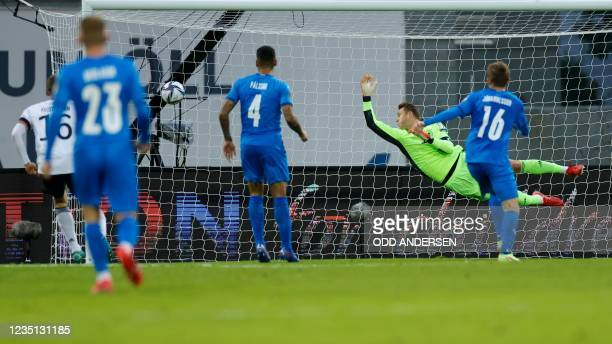Germany's goalkeeper Manuel Neuer jumps to save a goal that was disallowed during the FIFA World Cup Qatar 2022 qualification Group J football match...