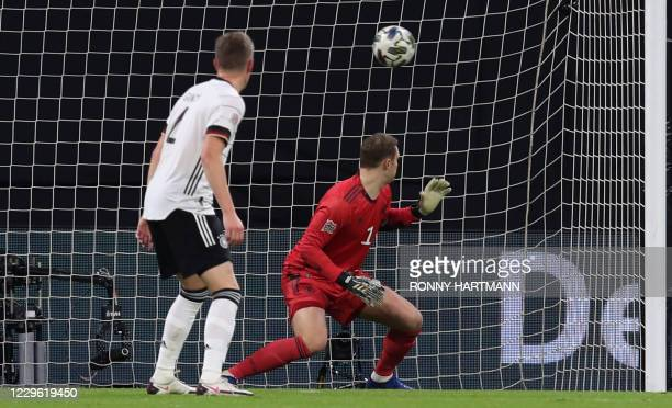 Germany's goalkeeper Manuel Neuer looks after the ball as Ukraine scores the 0-1 during the UEFA Nations League Group 4 football match of Germany vs...