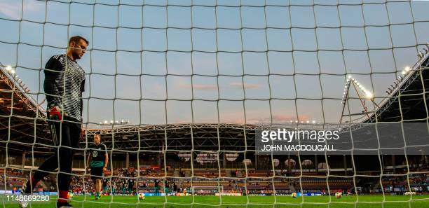 Germany's goalkeeper Manuel Neuer mans the goal as goalkeeper coach Andreas Koepke looks on during a warm up session prior to the Euro 2020 football...