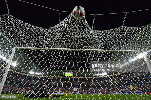 TOPSHOT Germany's goalkeeper Manuel Neuer misses the ball by Italy's defender Andrea Barzagli during a spotkick in the penalty shootout in the Euro...