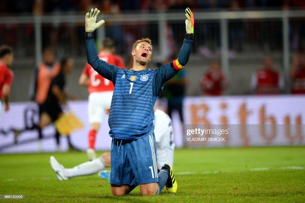 TOPSHOT - Germany's goalkeeper Manuel Neuer reacts after conceding the second Austrian goal during the international friendly footbal match Austria v Germany in Klagenfurt, Austria, on June 2, 2018.