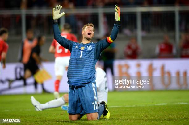TOPSHOT Germany's goalkeeper Manuel Neuer reacts after conceding the second Austrian goal during the international friendly footbal match Austria v...