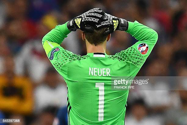 Germany's goalkeeper Manuel Neuer reacts after German lost 20 to France in the Euro 2016 semifinal football match between Germany and France at the...