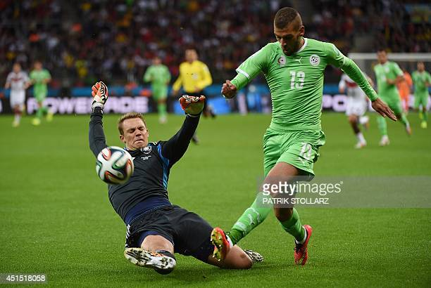 Germany's goalkeeper Manuel Neuer tackles Algeria's forward Islam Slimani during a Round of 16 football match between Germany and Algeria at BeiraRio...