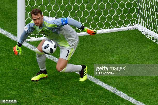TOPSHOT Germany's goalkeeper Manuel Neuer tries to make a save during the Russia 2018 World Cup Group F football match between South Korea and...
