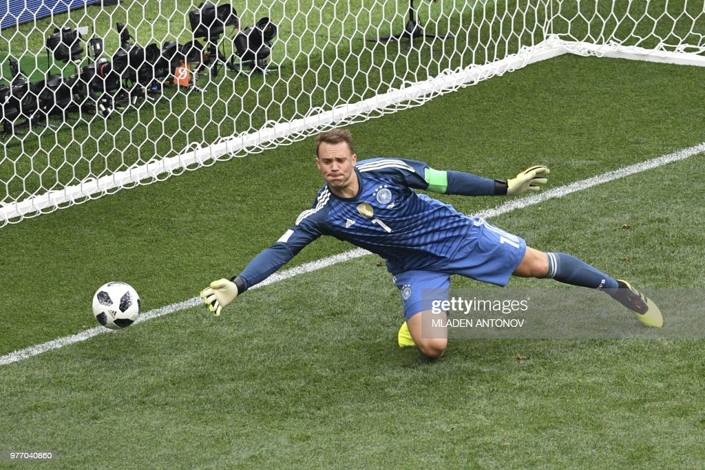 TOPSHOT - Germany's goalkeeper Manuel Neuer tries to save a shot during the Russia 2018 World Cup Group F football match between Germany and Mexico at the Luzhniki Stadium in Moscow on June 17, 2018. (Photo by Mladen ANTONOV / AFP) / RESTRICTED