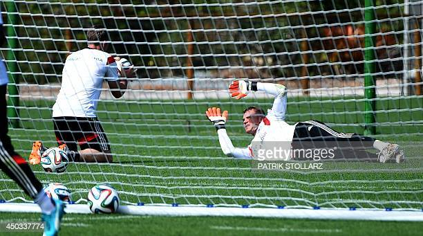 Germany's goalkeeper Manuel Neuer warms up during a training session of Germany's national football team in Santo Andre on June 9 2014 ahead of the...