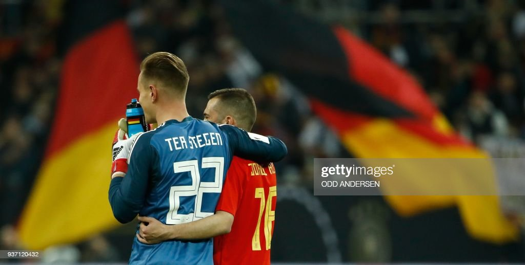 Germany's goalkeeper Marc-Andre ter Stegen (L) and Spain's defender Jordi Alba leave the pitch after the international friendly football match of Germany vs Spain in Duesseldorf, western Germany, on March 23, 2018, in preparation of the 2018 Fifa World Cup. / AFP PHOTO / Odd ANDERSEN