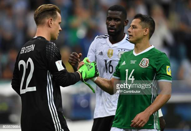 Germany's goalkeeper MarcAndre Ter Stegen shakes hands with Mexico's forward Javier Hernandez after the 2017 Confederations Cup semifinal football...