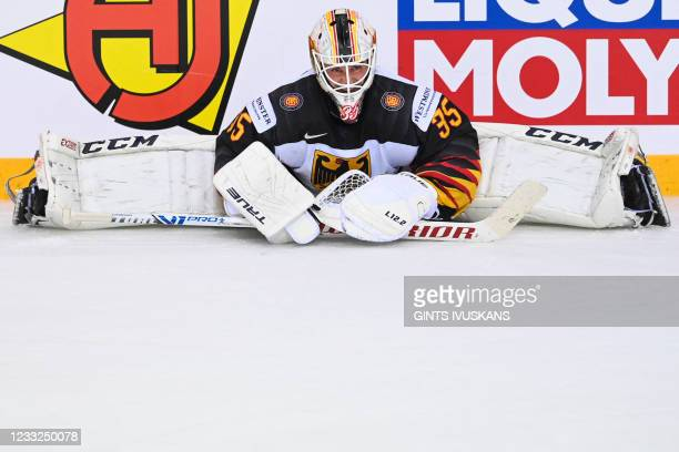 Germany's goalkeeper Mathias Niederberger stretches in preparation for the shootout during the IIHF Men's Ice Hockey World Championships quarter...