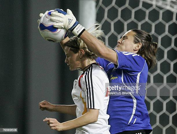 Germany's goalkeeper Nadine Angerer fights for the ball with Martina Mueller during a training session 07 September 2007 in Shanghai ahead of the...