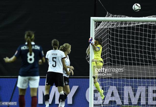 Germany's goalkeeper Nadine Angerer jumps for the ball during the quarter-final football match between Germany and France during their 2015 FIFA...