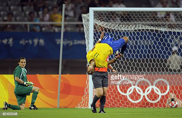 Germany's goalkeeper Nadine Angerer looks at Brazil's Cristiane after scoring a goal during the 2008 Beijing Olympic Games women's semifinal football...