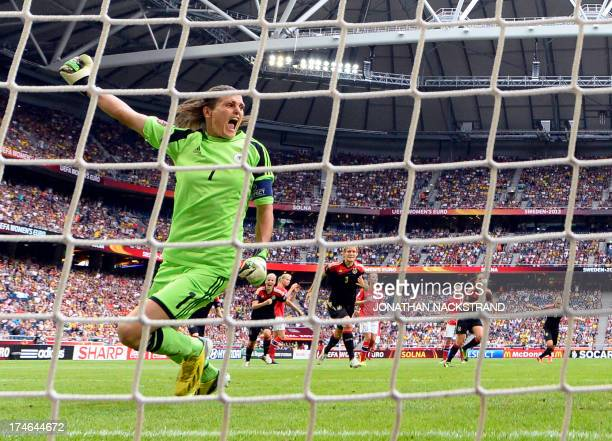 Germany's goalkeeper Nadine Angerer reacts after she saved a penalty shot during the UEFA Women's European Championship Euro 2013 final Germany vs...