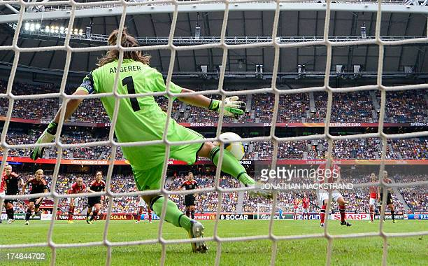 Germany's goalkeeper Nadine Angerer saves a penalty shot during the UEFA Women's European Championship Euro 2013 final Germany vs Norway on July 28...