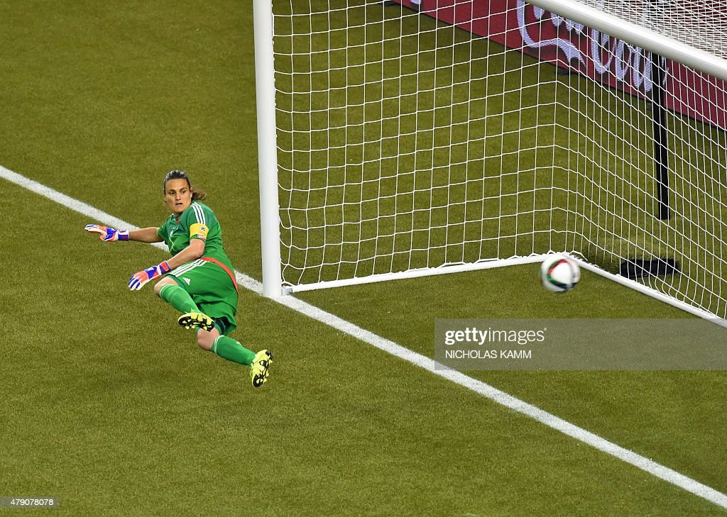 Germany's goalkeeper Nadine Angerer watches as a USA penalty shot goes in during their 2015 FIFA Women's World Cup semifinal match at Olympic Stadium in Montreal on June 30, 2015.