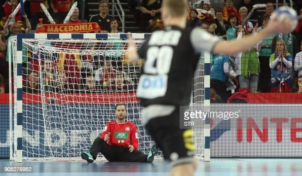 Germany's goalkeeper Silvio Heinevetter prepares to block the ball during the group C handball match of the Men's 2018 EHF European Handball...