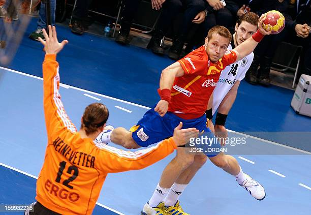 Germany's goalkeeper Silvio Heinevetter vies with Spain's right wing Victor Tomas during the 23rd Men's Handball World Championships quarterfinal...