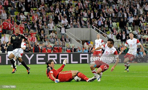 Germany's goalkeeper Tim Wiese and Poland's midfielder Slawomir Peszko vie for the ball during the International friendly football match Poland vs...