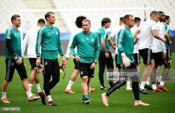 Germany's goalkeepers Bernd Leno Manuel Neuer and MarcAndre ter Stegen arrive with goalkeeper coach Andreas Koepke for a training session at the...