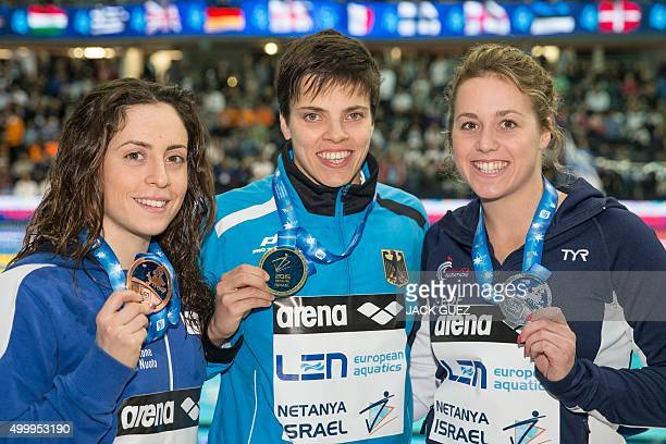 Germany's gold medalist Franziska Hentke French silver medalist Lara Grangeon and Italian bronze medalist Alessia Polieri stand on the podium after...