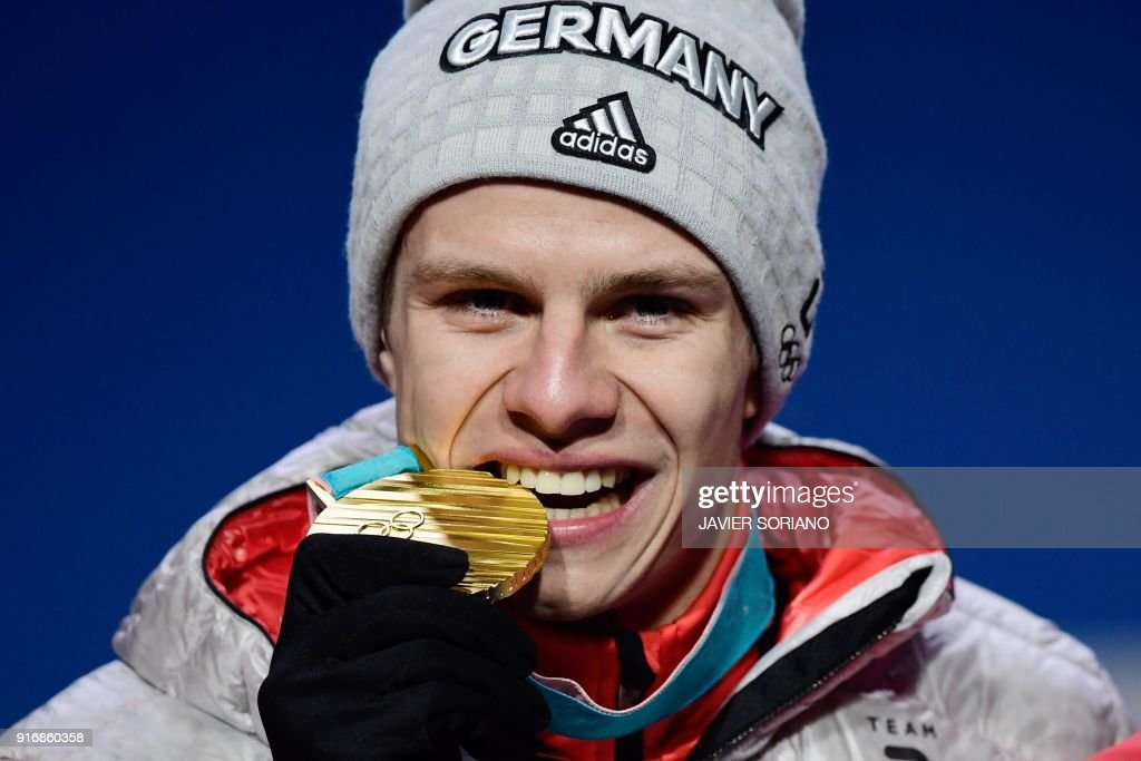 Germany's gold medallist Andreas Wellinger poses on the podium during the medal ceremony for the ski jumping Men's Normal Hill Individual at the Pyeongchang Medals Plaza during the Pyeongchang 2018 Winter Olympic Games in Pyeongchang on February 11, 2018. /