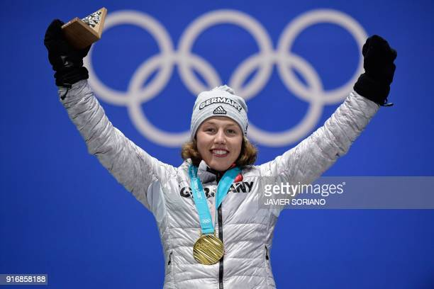 Germany's gold medallist Laura Dahlmeier poses on the podium during the medal ceremony for the biathlon Women's 7.5km Sprint at the Pyeongchang...