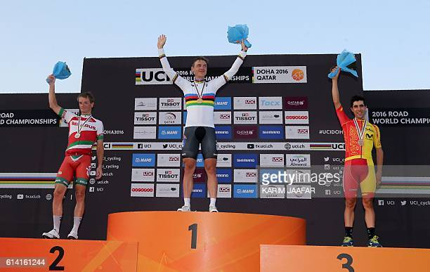Germany's gold medallist Tony Martin Belarus' silver medallist Vasil Kiryienka and Spain's bronze medallist Jonathan Castroviejo celebrate on the...