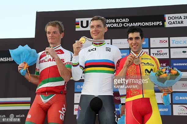 Germany's gold medallist Tony Martin , Belarus' silver medallist Vasil Kiryienka and Spain's bronze medallist Jonathan Castroviejo celebrate on the...