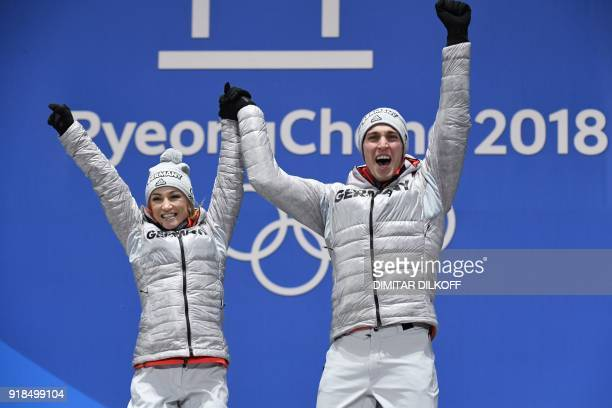 Germany's gold medallists Aljona Savchenko and Bruno Massot pose on the podium during the medal ceremony for the figure skating pair event at the...