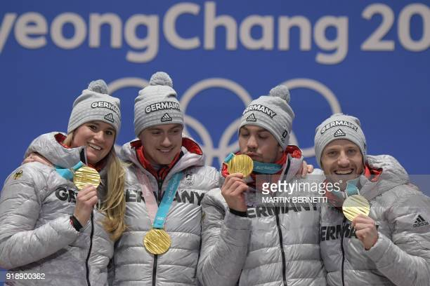 Germany's gold medallists Natalie Geisenberger Johannes Ludwig Tobias Wendl and Tobias Arlt pose on the podium during the medal ceremony for the luge...
