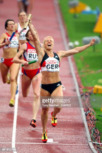 Germany's Grit Breuer celebrates bringing home the 4 x 400m Relay team for the gold medal
