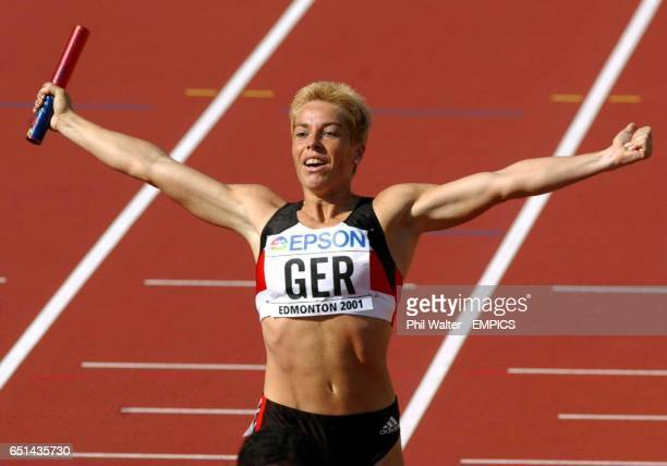 Germany's Grit Breuer celebrates her team's 2nd placing in the final of the Womens 4 x 400 meters relay.