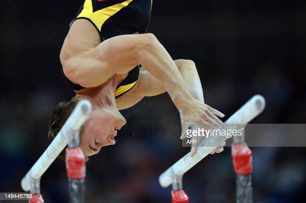 Germany's gymnast Philipp David Boy competes on the parrallel bars during the men's qualification of the artistic gymnastics event of the London...