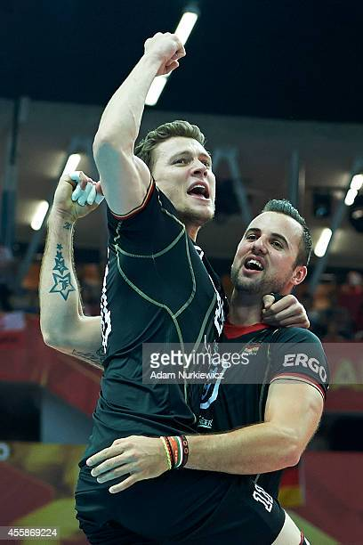 Germany's Gyorgy Grozer and Lukas Kampa celebrate winning the point and bronze medal during the FIVB World Championships match 3rd/4th Playoff...