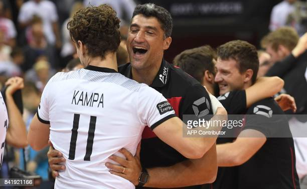 Germany's head coach Andrea Giani and Lukas Kampa of Germany celebrate after the semifinal match between Serbia and Germany of the 2017 CEV Men's...