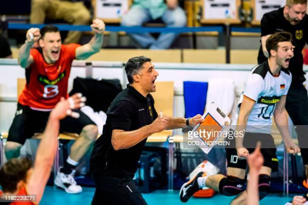 Germany's head coach Andrea Giani and players react at matchpoint after defeating Belgium's team during the pool A Men's CEV Tokyo Volleyball...