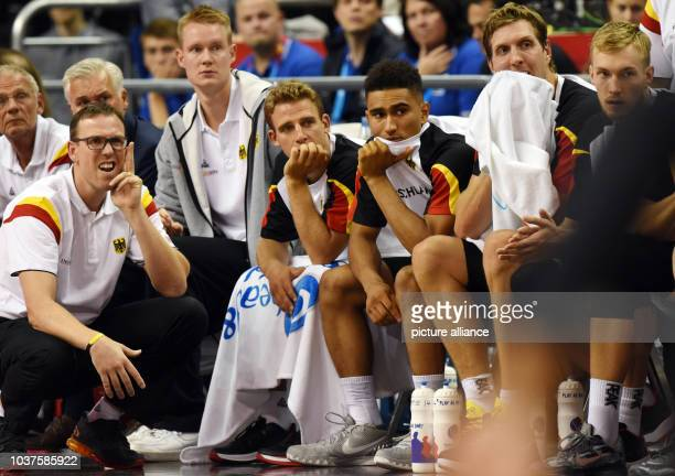 Germany's head coach Chris Fleming and players Robin Benzing Heiko Schaffartzik Maodo Lo Dirk Nowitzki and Niels Giffey follow the European...