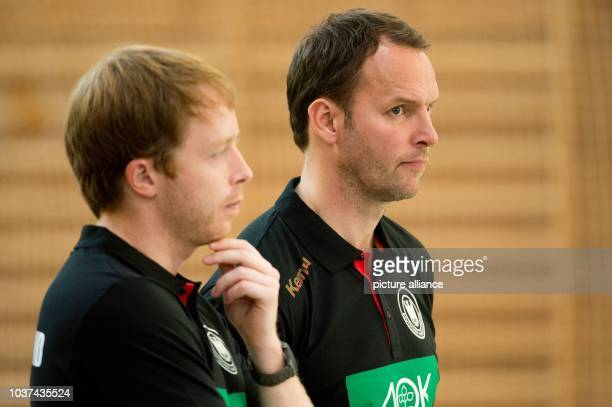 Germany's head coach Dagur Sigurdsson and assistant coach Jochen Beppler stand during a training session with a handball in the Roemerhalle...