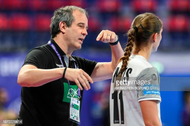 Germany's head coach Henk Groener speaks with Germany's left back Xenia Smits during the 2018 European Women's handball Championships Group 2 main...