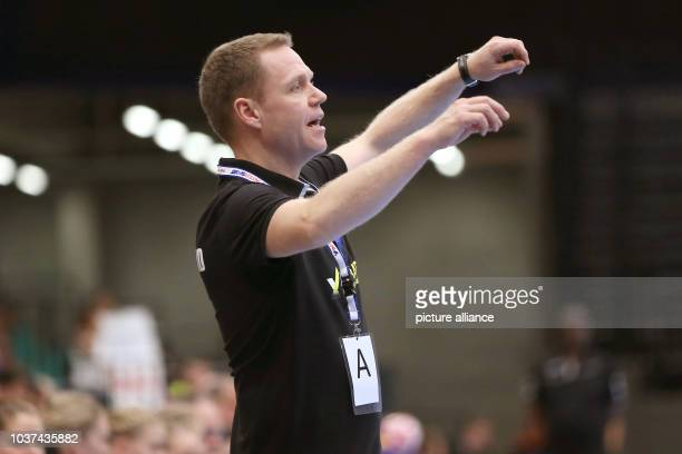 Germany's head coach Jakob Vestergaard instructs players during a handball match between Germany and the DR Congo at the IHF Women's Handball World...