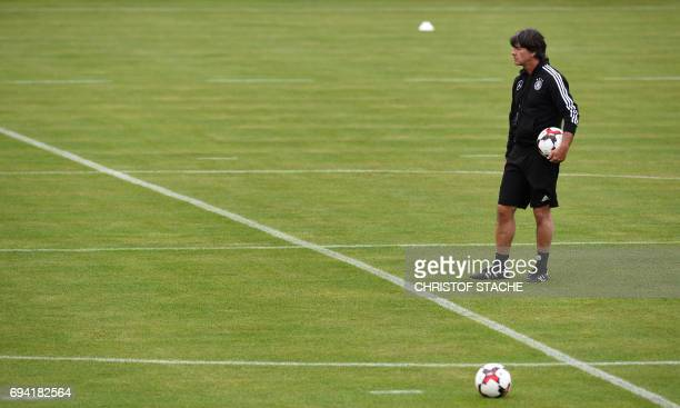 Germany's head coach Joachim Loew follows a training session in Herzogenaurach southern Germany on June 9 2017 on the eve of the FIFA World Cup 2018...