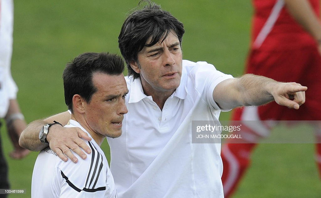 Germany's head coach Joachim Loew (R) speaks to Germany's midfielder Piotr Trochowski following a training match Germany vs Sued Tyrol FC at the team's training centre in Appiano, near the north Italian city of Bolzano May 24, 2010. The German football team is currently taking part in a 12-day training camp in Appiano to prepare for the upcoming FIFA Football World Cup in South Africa.