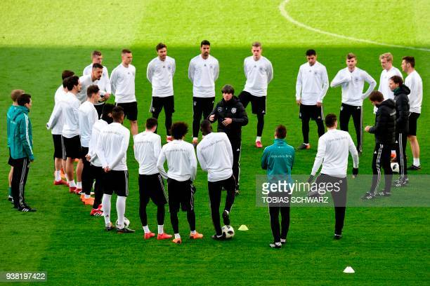 Germany's head coach Joachim Loew speaks to his players during a training session on the eve of the friendly football match Germany vs Brazil in...