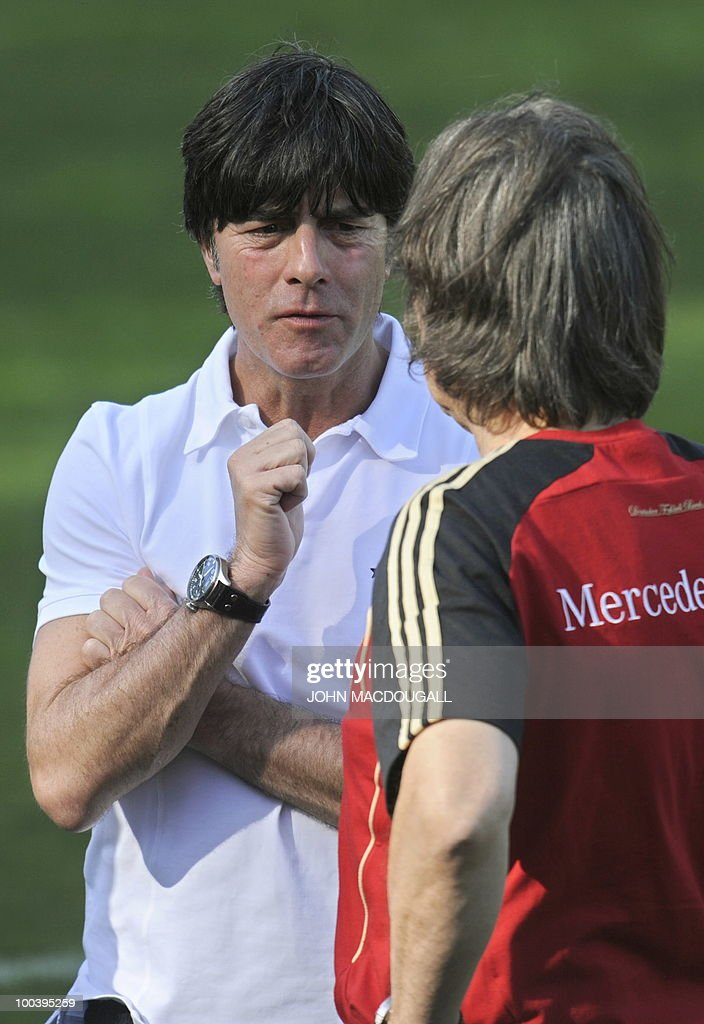 Germany's head coach Joachim Loew (L) speaks to team doctor Hans-Wilhelm Mueller-Wohlfahrt prior to a training match Germany against Sued Tyrol FC at the team's training centre in Appiano, near the north Italian city of Bolzano May 24, 2010. The German football team is currently taking part in a 12-day training camp in Appiano to prepare for the upcoming FIFA Football World Cup in South Africa.