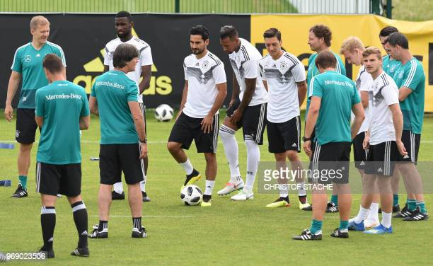 Germany's head coach Joachim Loew talks with his players during a training session of the German national football team at the Rungghof training...