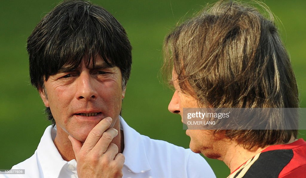 Germany's head coach Joachim Loew (L) talks with team doctor Hans Wilhelm Mueller-Wohlfahrt during a training match against Sued Tyrol FC at the team's training centre in Appiano, near the north Italian city of Bolzano May 24, 2010. The German football team is currently taking part in a 12-day training camp in Appiano to prepare for the upcoming FIFA Football World Cup in South Africa.