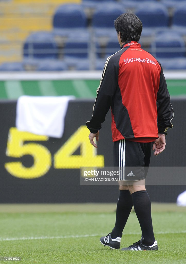 Germany's head coach Joachim Loew walks past the number 54 (Germany won the World Cup in 1954) during a training session at the Commerzbank Arena in the central German city of Frankfurt am Main on June 2, 2010. Germany is facing Bosnia-Herzegovina on June 3, 2010 in their last warm-up ahead of the FIFA 2010 World Cup in South Africa.